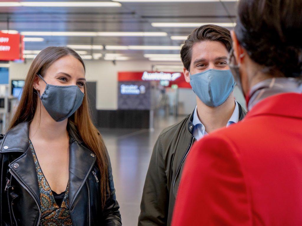 Austrian Airlines Passagiere mit Maske